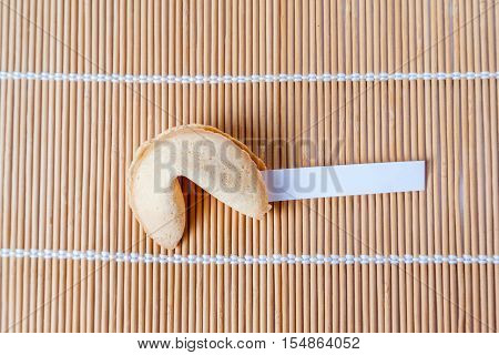 Fortune Cookie With Blank Slip On Bamboo Mat