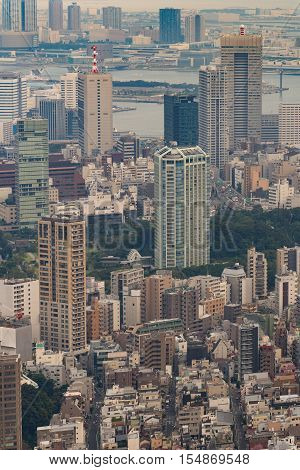 Tokyo Japan - September 26 2016: Aerial view since shot off Observatory tower. Multitude of highrise buildings and the mouth of the river in the background.