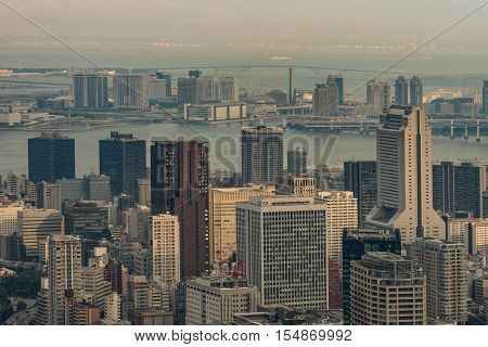 Tokyo Japan - September 26 2016: Aerial view since shot off Observatory tower. Plenty of harbor area behind multiple highrise buildings of which the tallest one is the NEC building on the right.