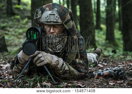 United states army ranger spotter in the forest