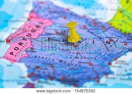 Madrid in Spain pinned on colorful political map of Europe. Geopolitical school atlas. Tilt shift effect.