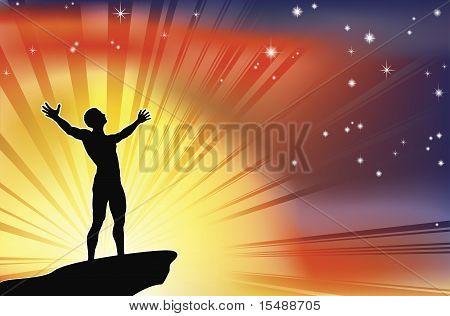 Man On Cliff Top With Arms Raised