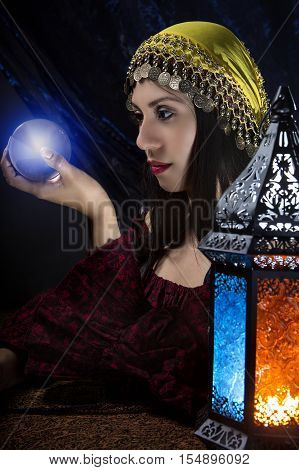 Psychic or diviner staring at a crystal ball to predict destiny or future. Astrology. Fortune Teller.