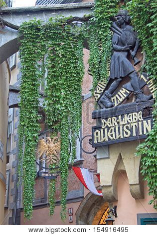 Vienna Austria - November 6 2015: Commemorative plaque on the facade of Griechenbeisl inn in Vienna Austria saying: Dear Augustin sang here his song the first time . Augustin was an Austrian minstrel and bagpiper
