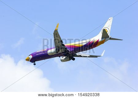 CHIANGMAI , THAILAND -APRIL 1 2014: HS-DBA Boeing 737-800 of NokAir ( Low-cost Airline ), Landing to Chiangmai airport from Bangkok Don Muang Airport.