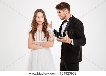 Photo of man argues with a girl. guy screaming at the girl