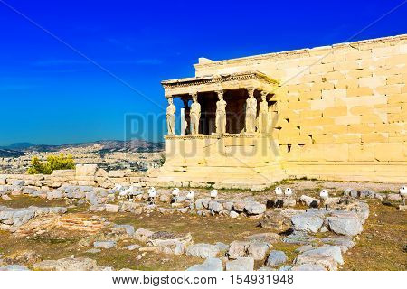 Background with Acropolis, Erechtheum Temple in Athens, Greece and blue sky