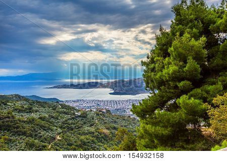 Volos city, sea gulf aerial view from Pelion mount and sun rays throung the clouds, Greece