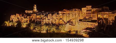 Pitigliano, Grosseto, Tuscany, Italy: night landscape of the picturesque medieval town founded in Etruscan time on the tuff hill