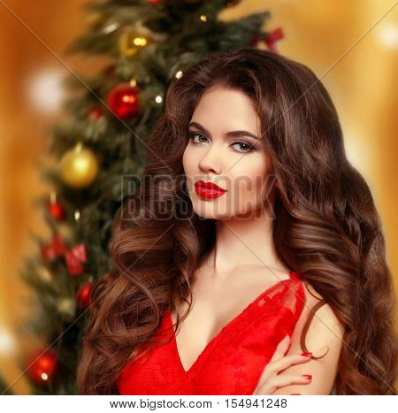 Christmas Woman. Beautiful Smiling Girl Model. Makeup. Healthy Long Hair Style. Manicured Nails. Ele
