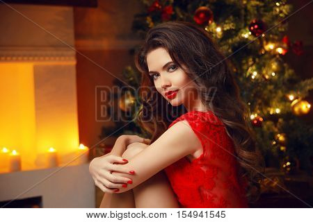 Christmas Santa. Beautiful Smiling Woman Model. Makeup. Healthy Long Hair Style. Elegant Lady In Red