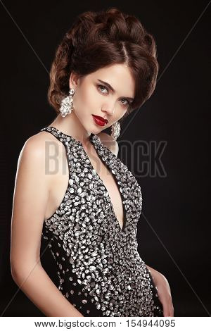 Makeup. Jewelry. Hairstyle. Fashion Lady. Beautiful Elegant Woman In Black Sexy Dress And Expensive