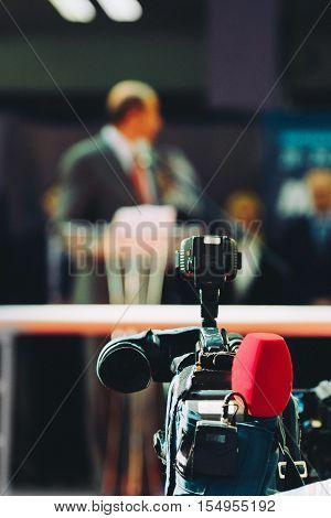 Television camera recording public event, toned image