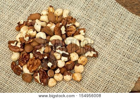 Mixed nuts on a burlap background.Closeup view.