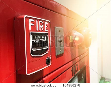 A Red Fire Alarm Switch. Red Fire Alarm. Push In Pull Down.