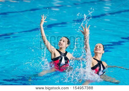 Competition in Synchronized Swimming, toned image, horizontal