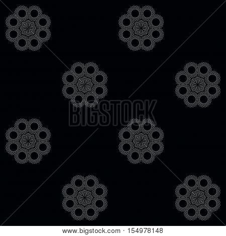 Vector seamless background in black and white. Lacy filigree elements. Pattern reminiscent of flowers.