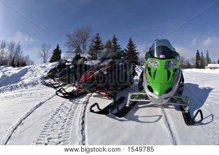 Four Snow Mobiles