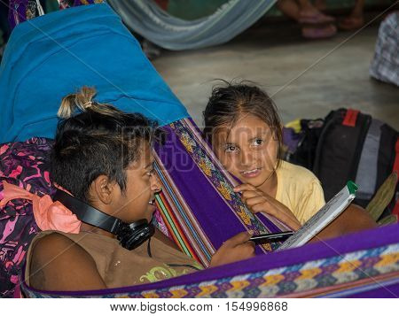 Woman And Girl On Cargo Boat