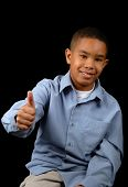image of young boy  - Young boy showing the thumbs - JPG
