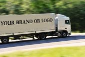 Big truck photographed from back side, no logo except great place for your logo or name of the brand poster