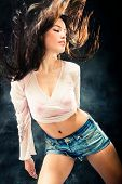 stock photo of brunette hair  - brunette woman with long hair dancing - JPG