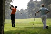 stock photo of golf  - Golf swing in riva dei tessali golf course italy - JPG