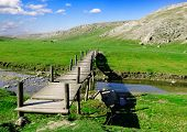 picture of old bridge  - The wooden foot bridge and old mountains - JPG