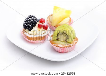 Three Cakes On The Plate. Isolated.