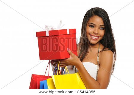 Young African American woman holding a present and shopping bags isolated on white background