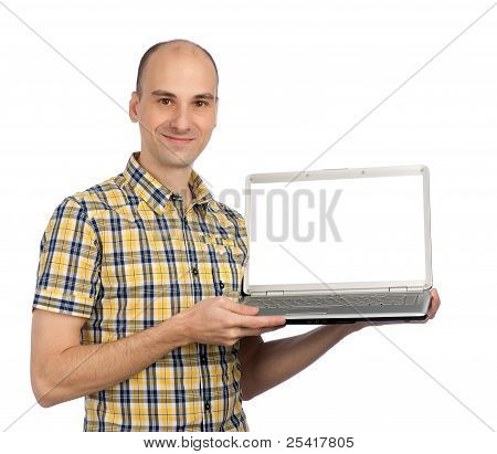 Portrait Of A Young Man Displaying A Computer