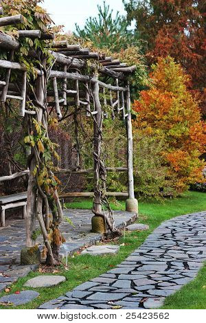 Wooden Bower In Autumn Garden