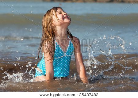 child playing in the ocean