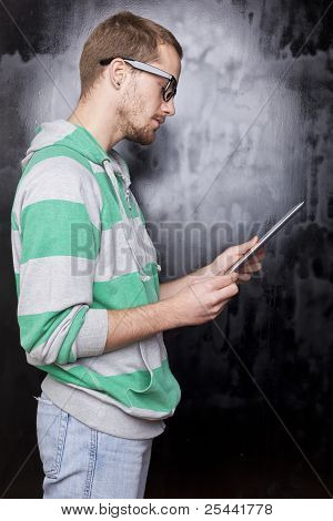 Good Looking Smart Geek Man With Tablet Computer
