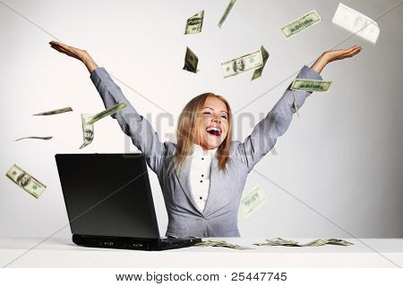 business woman drop dollars in the air