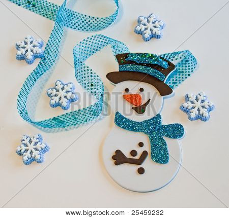 Snowman with cake snowflakes