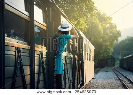 poster of Traveler Girl Leaving The Station By Train. Young Traveler Girl In Vacation. Girl Traveling By Train