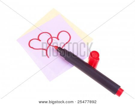 A drawn hearts with red marker on white background