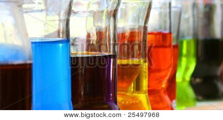 Row of glasses with colorful liquids