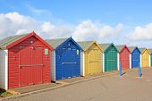 Multicoloured Beach Huts At Dawlish Warren, Devon poster