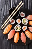Served A Set Of Sushi With Salmon And Tuna, California Rolls, Maki, Soy Sauce Closeup On The Table. poster