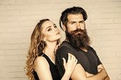 Man With Beard And Woman With Long Blond Hair. Girl And Bearded Hipster. Couple In Love Hug On White poster