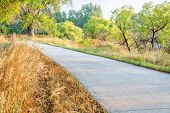 summer on the Poudre River Trail in northern Colorado near Windsor. It is a paved multi-use trail ex poster