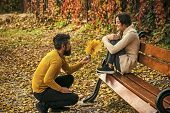 Nature Season And Fall Holiday. Man And Woman With Yellow Tree Leaves. Love Relationship And Romance poster