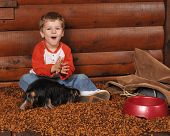 pic of bag-of-dog-food  - Prescool boy delighted with the heap of dry dog food he - JPG