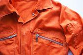 An Orange Jumpsuit Of A Prisoner. Close Up. Prison Clothes, Jumpsuit Sentenced To Correctional Labor poster