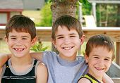 image of young boy  - Three Brothers With Arms Around Each Other Smiling - JPG