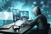 Side View Of Hacker Using Computer With Digital Interface While Sitting At Desk Of Blurry Interior.  poster