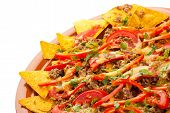 spicy nachos with pork, tomato and pepper poster