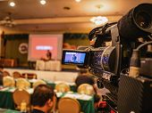 Close Up Professional Video Camera In Conference Hall Or Seminar Room With Attendee Background,educa poster